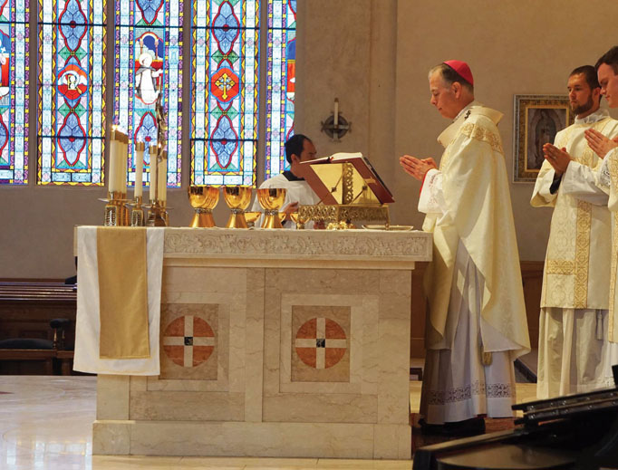 Archbishop Alexander Sample, shown celebrating Mass, says the aim of the 'Archdiocesan Liturgical Handbook' (shown below) is to emphasize the need to 'celebrate the liturgy according to the mind and heart of the Church.'  Archbishop Sample adds, 'We are called to celebrate the sacred liturgy not according to our own preferences, but to the way the Church asks us to celebrate the liturgy in continuity with the long Tradition of the Church.'