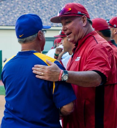 Louisiana State-Lafayette coach Tony Robichaux (r) greets LSU coach Paul Mainieri