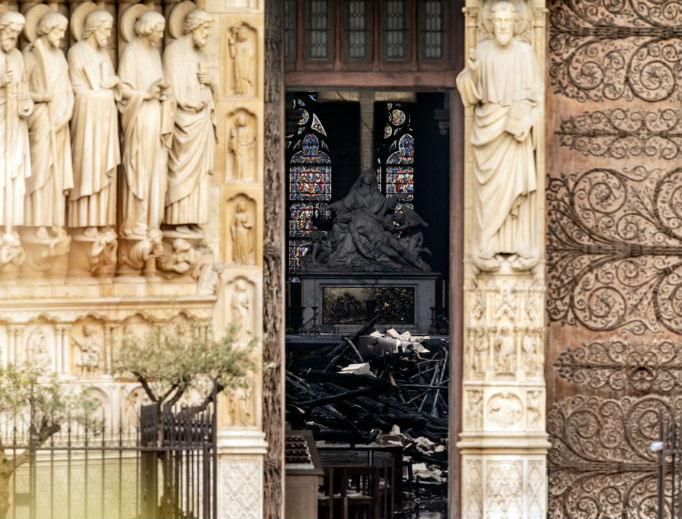 The interior of Notre Dame Cathedral, which suffered a devastating fire April 15, is seen through a doorway April 16.