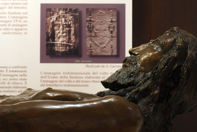 A bronze statue, titled 'The Body of the Man of the Shroud,' is seen in an exhibit on the Shroud of Turin at Regina Apostolorum University in Rome. The actual artifact is on display through May 23 in Turin.