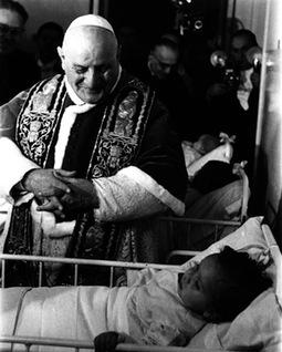 John XXIII visits children in a hospital.