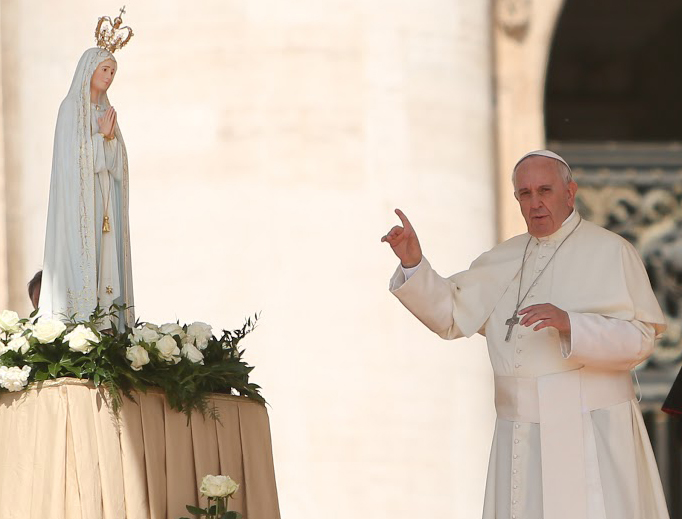 Vatican City - May 13, 2015. Pope Francis in front of a statue of Our Lady of Fatima on the feast day of Our Lady of Fatima, on May 13, 2015, in St. Peter's Square during the Wednesday General Audience.