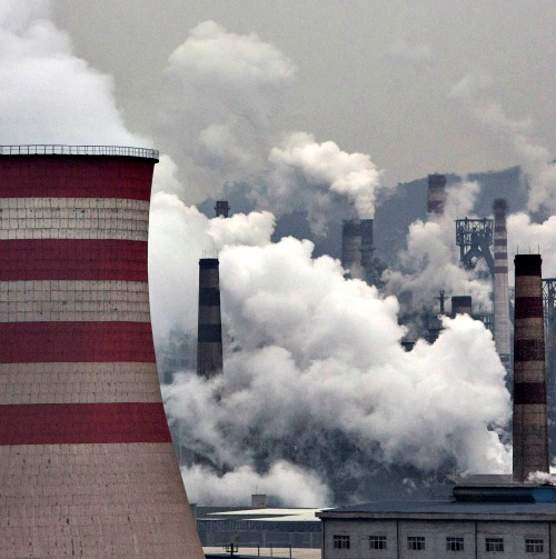 Smoke billows from smokestacks and a coal-fired generator at a steel factory on Nov. 19 in the industrial province of Hebei, China. At an upcoming conference in Paris, the governments of 196 countries will meet to set targets on reducing carbon emissions in an attempt to forge a new global agreement on climate change.