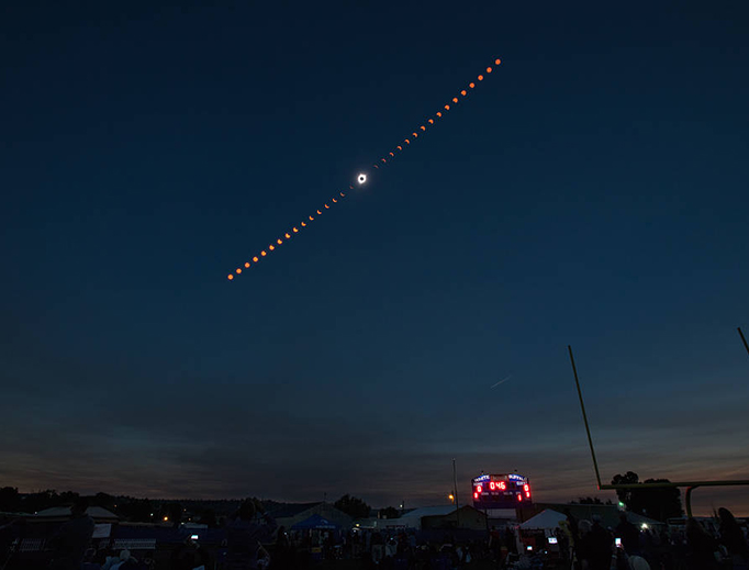 This composite image shows the progression of a total solar eclipse over Madras, Oregon on Monday, Aug. 21, 2017.