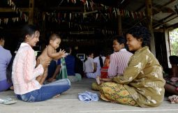 Women attend a workshop on breast-feeding at a Catholic Relief Services-supported clinic in Prey Pkosh, Cambodia, in August 2005. The workshop is part of a program that seeks to lower Cambodia's high maternal and infant mortality rates by monitoring the health of pregnant women, teaching safe birthing practices and encouraging new mothers to breast-feed and have their infants vaccinated.