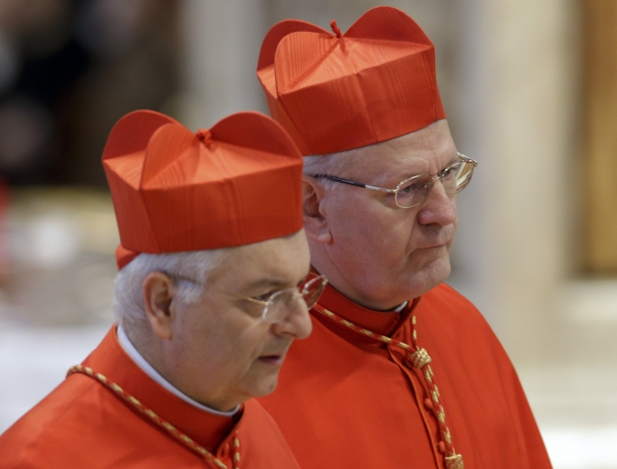 Cardinal Peter Erdo, of Hungary, right, and Cardinal Mauro Piacenza attend a Mass during the papal conclave at St. Peter's Basilica March 12, 2013. Cardinal Piacenza has written a new book about confession.