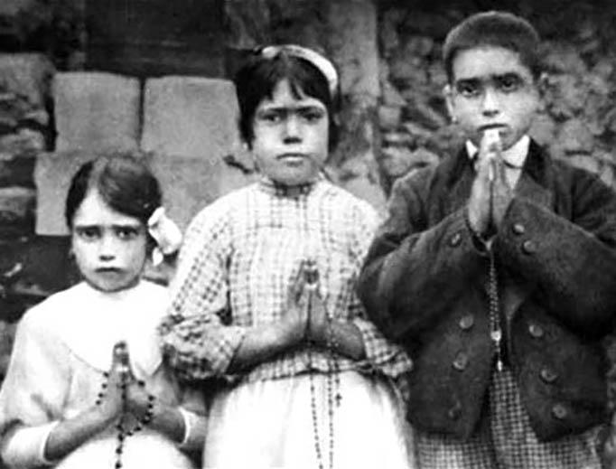 From left: Jacinta Marto (age 7), Lúcia Santos (age 10) and Francisco Marto (age 9)