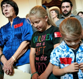 Pro-life supporters pray in the Texas State Capitol July 1 prior to the vote to prohibit abortions in Texas after 20 weeks of a woman's pregnancy.