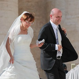 A newly married couple at the Vatican waits to be blessed by Pope Francis on Oct. 16, 2013.