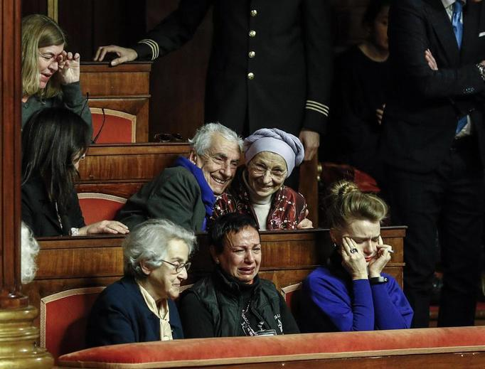 Former abortionist and Radical Party activist Emma Bonino, center, reacts with emotion Dec. 14 in Rome to the announcement that the Italian Senate has passed a law allowing citizens the right to refuse artificial nutrition and hydration in living wills.