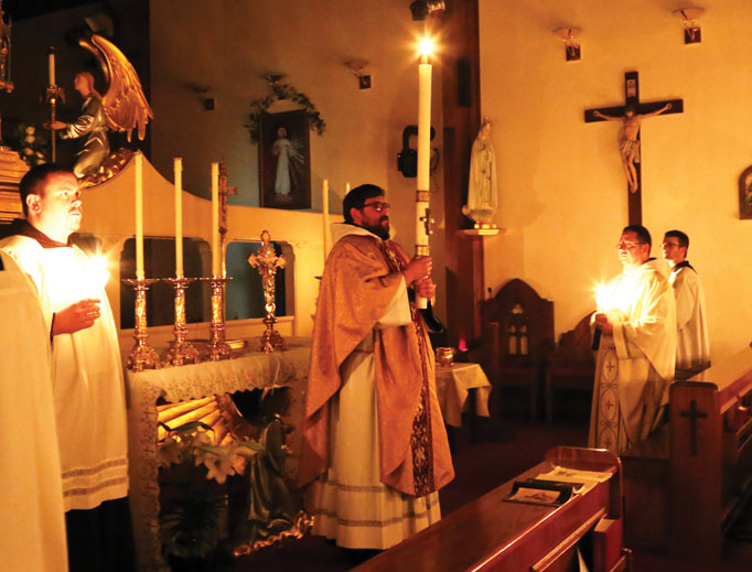 The Franciscan Missionaries of the Eternal Word celebrate the Easter vigil each year — Father Leonard Mary is shown above in 2016 and images of the 2018 vigil are below — with the reverence and hope the liturgy fosters for the faithful.