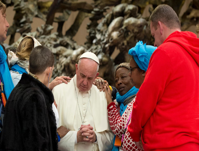 Pope Francis meets with pilgrims during a jubilee audience in the Paul VI Hall on Nov. 11.