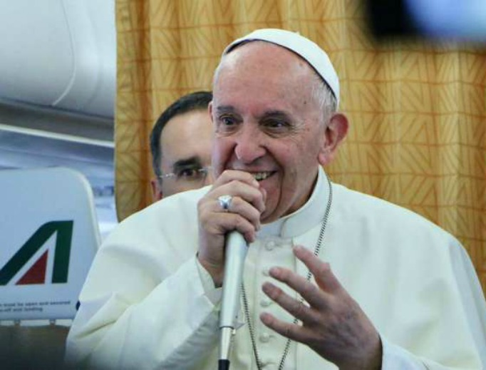 Pope Francis aboard the papal plane on April 29.