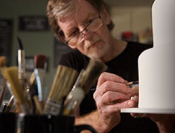 Jack Phillips works on a cake, as his creativity reflects his Christian faith.