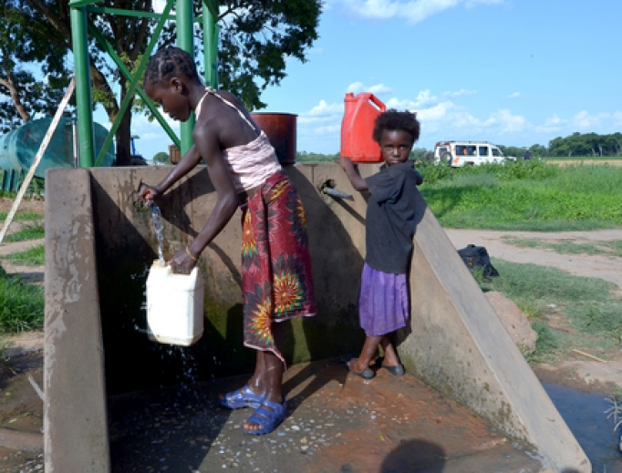 African children fetch water many miles away from home and do not attend school to help their family in Lusaka, Zambia.