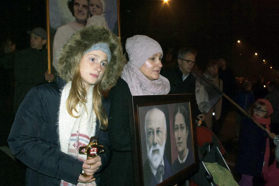 ABOVE: Poles participate in the All Saints' Ball Oct. 31, 2019 (Paweł Siciński/EWTN Polska). BELOW: Beskiel Cemetery, Oswiecim, Poland, Nov. 1, 1984 (John Thaxter/CC0/Wikimedia Commons)