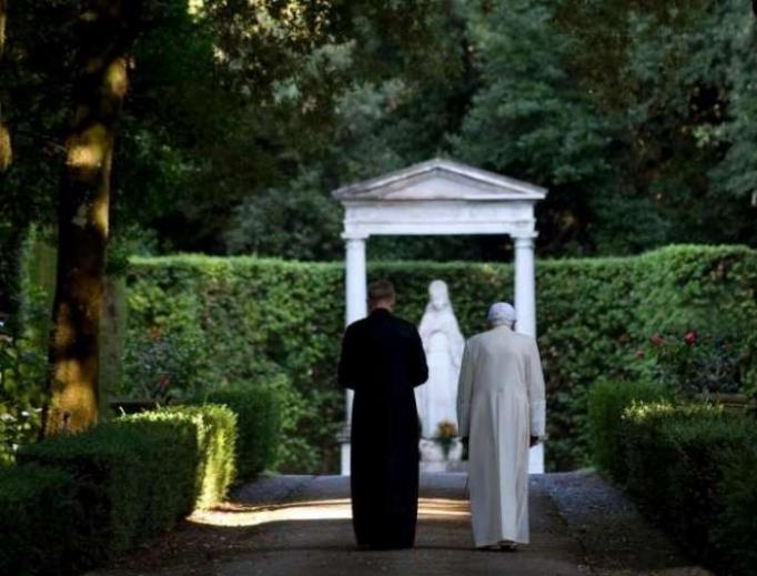 Pope emeritus Benedict XVI walking in the gardens at Castel Gandolfo.
