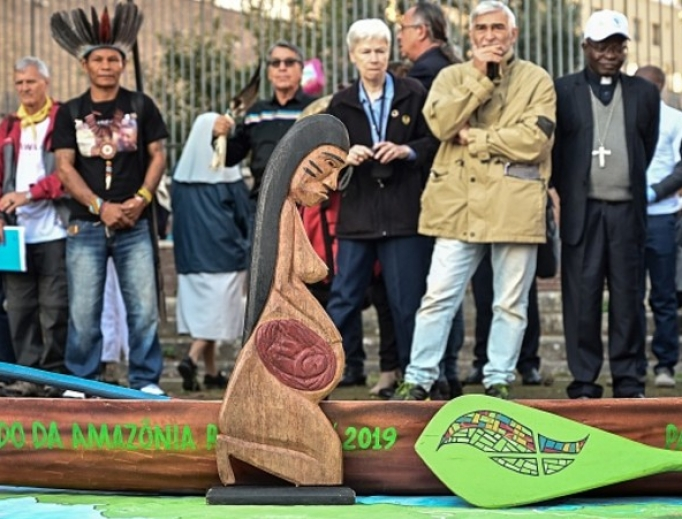 A wooden carved sculpture is pictured during a procession of indigenous leaders, prelates and people participating in the Special Assembly of the Synod of Bishops for the Pan-Amazon Region, on Oct. 19 between Rome's Castel Sant'Angelo and the Vatican's St. Peters Square.