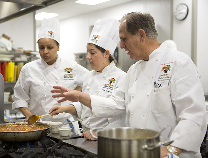 Chef Folse instructs students at the Chef John Folse Culinary Institute