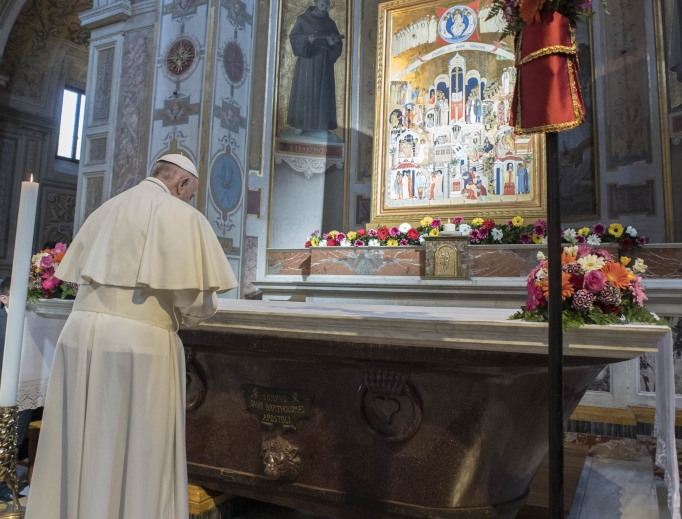 Pope Francis prays at the Church of San Bartolomeo in Rome on April 22.