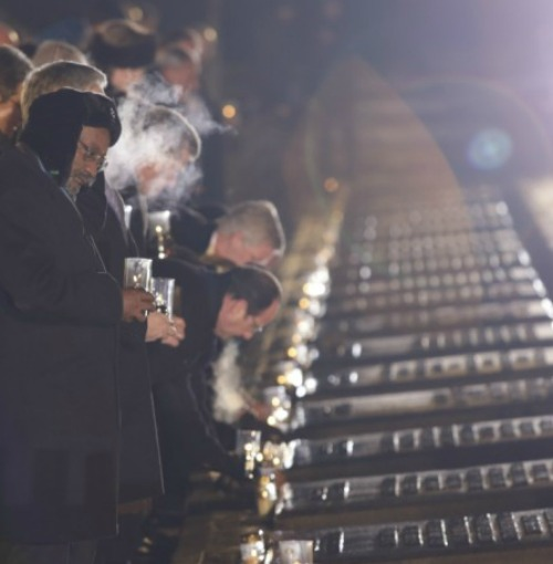 Survivors of Auschwitz, accompanied by representatives from more than 40 nations, met in front of the concentration camp's Death Gate Jan. 27 to commemorate the 70th anniversary of the liberation of its prisoners.