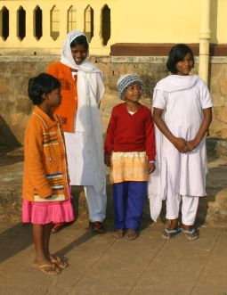 Lipsarani Digal, second from right, stands with other girls outside a church hostel in Kandhamal, India, in December last year. The girls' fathers were all killed in 2008 attacks on Christians in Orissa state.
