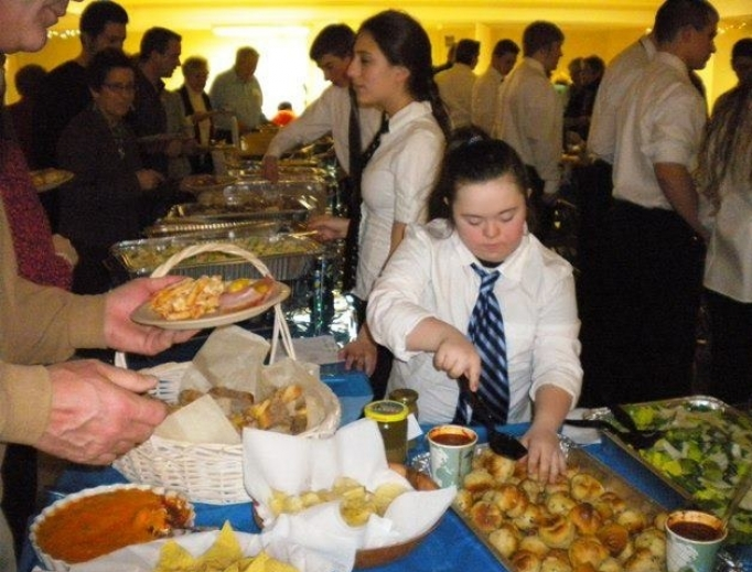 Above, Grace serves parishioners at her home parish of Notre Dame in Caldwell, New Jersey.