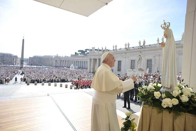 Pope Francis prays in front of a statue of Our Lady of Fatima on the feast day of Our Lady of Fatima, May 13, 2015, in St. Peter's Square.