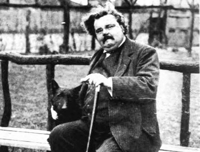 British writer G.K. Chesterton, shown in a portrait circa 1920, may be considered for sainthood. A priest has been investigating his life and will share his findings soon.