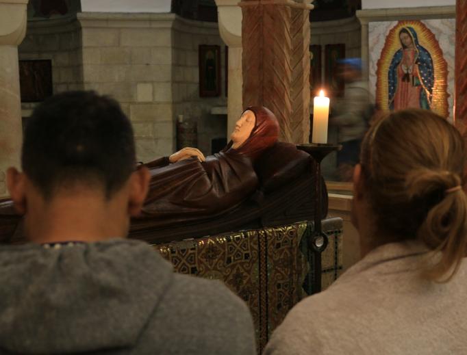 Faithful pray inside Dormition Abbey on Mount Zion.