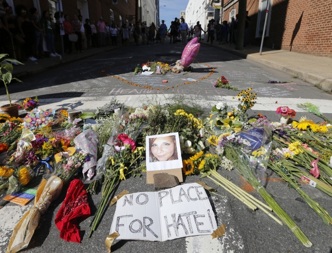 A makeshift memorial of flowers and a photo of victim Heather Heyer sits in Charlottesville, Virginia, Aug. 13. Heyer died when a car rammed into a group of people who were protesting the presence of white supremacists who had gathered in the city for a rally.