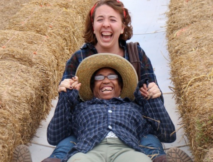 Sarah Ruszkowski and Eileen Schofield delight in going down a slide together at Cox Farm.