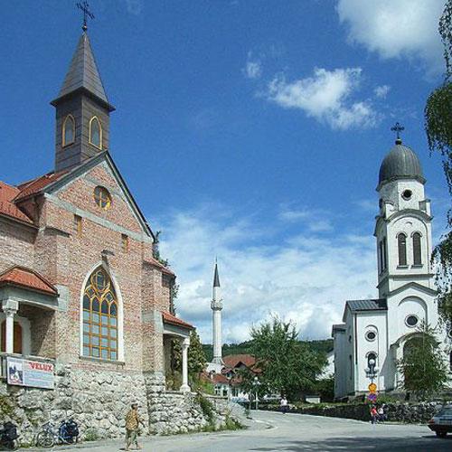 A Catholic church, a mosque and a Serbian Orthodox church in Bosanska Krupa, Bosnia and Herzegovina.