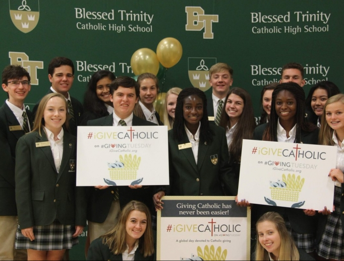 Above, Students from Blessed Trinity High School in Roswell, Georgia, in the Archdiocese of Atlanta are blessed by the generosity of iGiveCatholic. Below,  the Archdiocese for the Military Services participates in the giving campaign to raise funds for military priests; and Father Mitch Semar, pastor of St. Thomas Aquinas Catholic Church and Student Center at Nicholls State College, shown with the Colonel mascot, and students at Nicholls State University in Thibodaux, Louisiana, in the Diocese of Houma-Thibodaux, were able to fundraise for their new Two Hearts Perpetual Adoration Chapel.