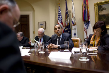 President Barack Obama holds a roundtable briefing July 2 in the Roosevelt Room with Catholic press, including Register publisher Father Owen Kearns (left foreground).