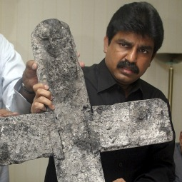 GUNNED DOWN. Shahbaz Bhatti, a Catholic and Pakistan's minorities minister, shows a cross that was burned during an attack on a church in central Punjab province during a news conference in Islamabad in 2005. Bhatti, who had called for changes in the country's controversial blasphemy law, was shot when gunmen opened fire on his vehicle in Islamabad March 2. He later died from massive gunshot wounds at a local hospital.