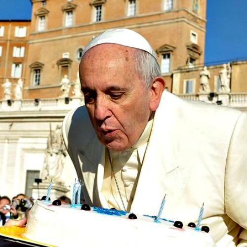 Pope Francis blows out candles on a cake for his 78th birthday in St. Peter's Square during his Wednesday general audience on Dec. 17.