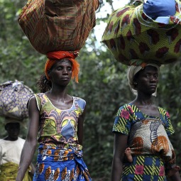 Refugees from Ivory Coast walk with their belongings through Grand Gedeh County in eastern Liberia March 23.