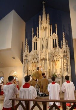 Mass being celebrated at the central altar of Our Lady of Mount Carmel Church in Littleton, Colo.