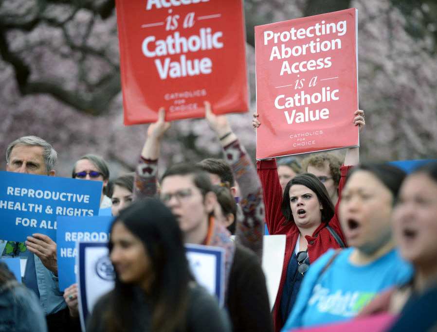 """People attend a """"Fight4Her"""" pro-abortion rally in front of the White House at Lafayette Square on March 29, 2019, in Washington, D.C. A coalition of NARAL Pro-Choice America, Planned Parenthood and Population Connection Action Fund gathered to demand the end of the pro-life Mexico City Policy."""