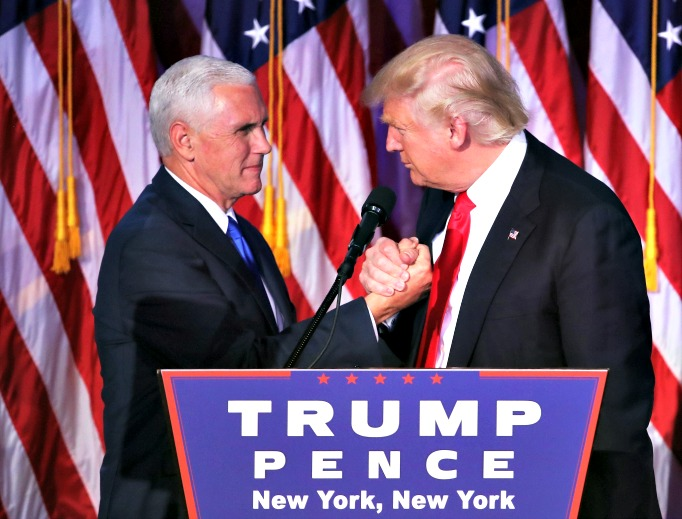 President-elect Donald Trump and his running mate Mike Pence shake hands after his victory speech Nov. 9 at the New York Hilton Midtown. Donald Trump defeated Democratic presidential nominee Hillary Clinton to become the 45th president of the United States.