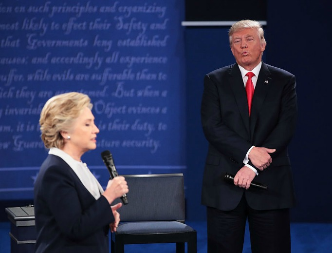 Democratic presidential nominee Hillary Clinton speaks as Republican presidential nominee Donald Trump listens during the town-hall debate at Washington University on Oct. 9 in St. Louis, Missouri.