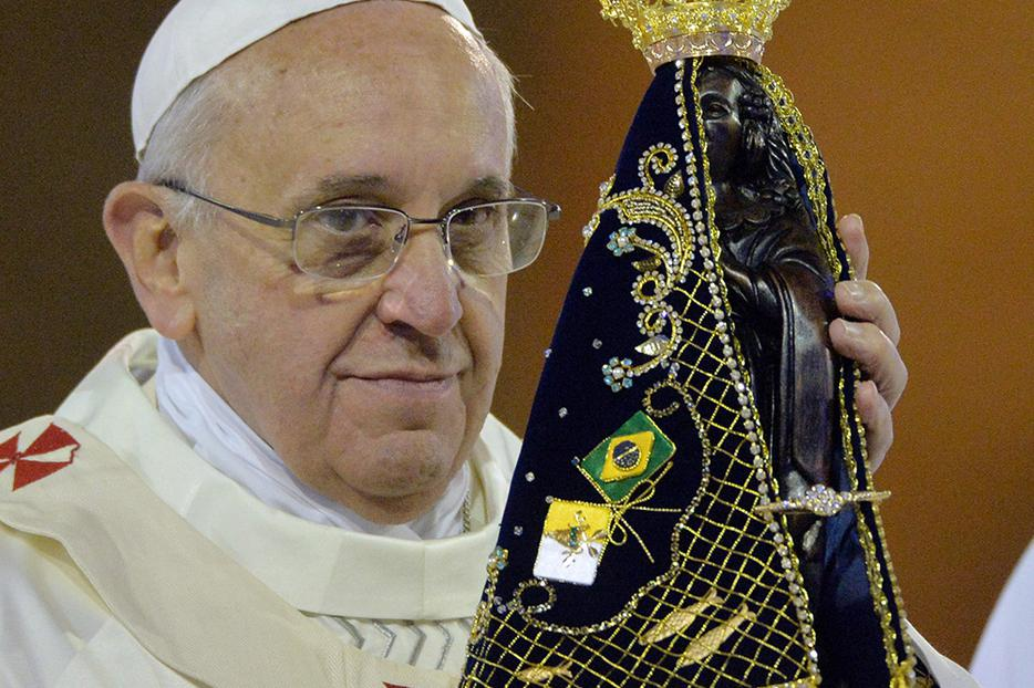 Pope Francis holds the statue of Our Lady of Aparecida at Brazil's National Shrine of Our Lady of Aparecida on July 24, 2013.