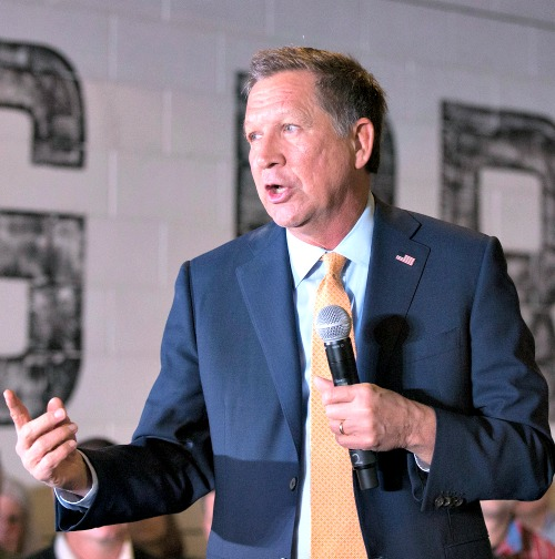 Republican presidential candidate Ohio Gov. John Kasich speaks at a campaign rally at the Lansing Brewing Company on March 8 in Lansing, Mich.