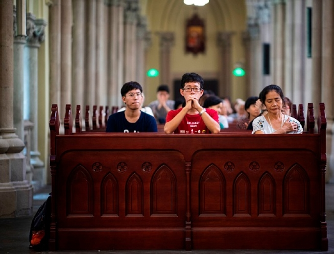 Catholics attend a mass at the government-sanctioned St. Ignatius Catholic Cathedral in Shanghai on September 30, 2018. China and the Vatican signed a provisional agreement on September 22.