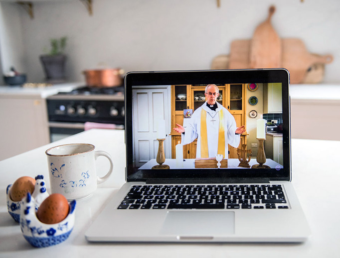 In this photo illustration the Anglican archbishop of Canterbury, Justin Welby, gives the first national digital Easter Sunday service from his kitchen at Lambeth Palace on April 12 in London, England.