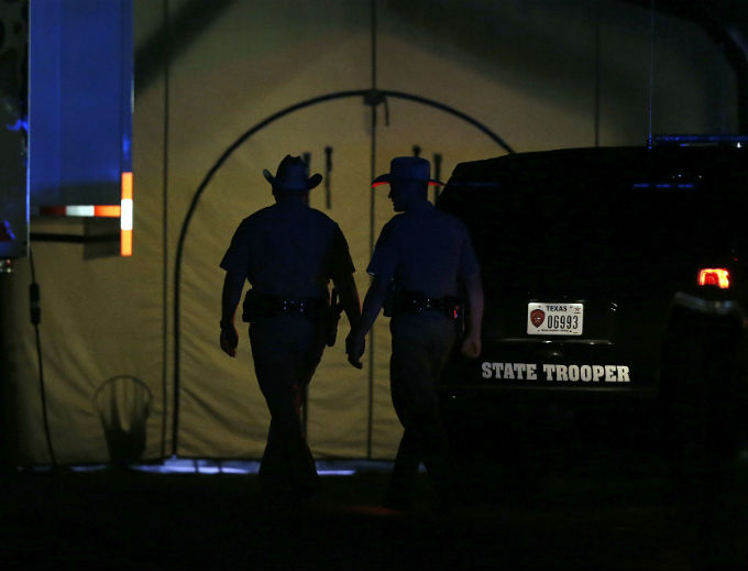 Law enforcement officials work at scene of a shooting at the First Baptist Church of Sutherland Springs, Texas, Nov 5.
