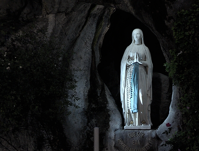 A statue of Our Lady of Lourdes in the grotto at the shrine of Our Lady of Lourdes in Lourdes, France.