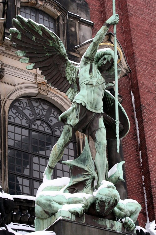 Statue of St. Michael defeating the devil in Hamburg, Germany