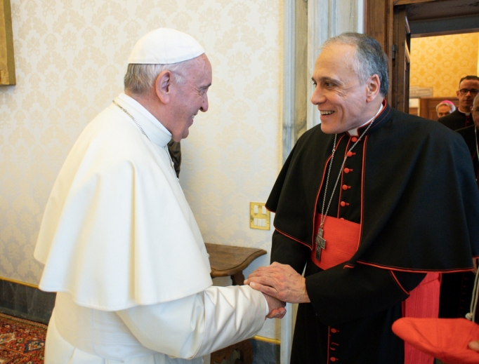 Pope Francis greets Cardinal Daniel DiNardo, the president of the U.S. Conference of Catholic Bishops, before a private audience Sept. 13 at the Vatican.